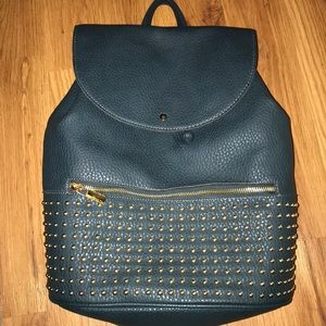 blueish green faux leather backpack